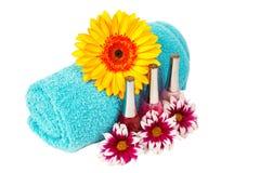 Turquoise towel, nail polish, gerbera Stock Photo