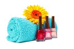 Turquoise towel, nail polish, gerbera Stock Image