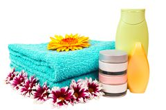 Turquoise towel, nail polish, gerbera Stock Photo