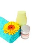 Turquoise towel, nail polish, gerbera Stock Images