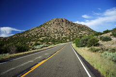 The Turquoise Trail. As it approaches  Madrid, New Mexico Royalty Free Stock Images