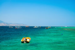 Turquoise tropical sea and boats Stock Photo