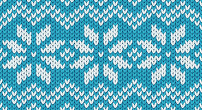 Turquoise vector realistic knit seamless pattern with white snowflakes and zig zag ornament Royalty Free Stock Images