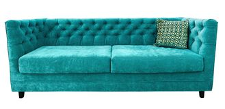 Turquoise velor sofa with pillow. Soft emerald couch. Isolated background. Green sofa with pillow. Soft emerald couch. Isolated background royalty free stock photo