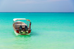 Turquoise Water and Boat Royalty Free Stock Photography