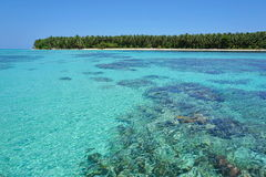 Turquoise water of the Caribbean sea with island Stock Images