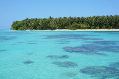 Turquoise water with corals and tropical island Royalty Free Stock Photography