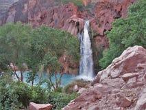 Havasu Falls. Turquoise water fills the pool beneath Havasu Falls in Havasu Canyon royalty free stock photo
