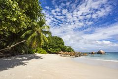 Paradise beach at anse lazio on the seychelles 93. Turquoise water, granite rocks and palm trees in the white sand on the paradise beach at anse lazio on the Royalty Free Stock Photo