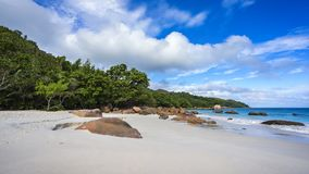 Paradise beach at anse lazio on the seychelles 17. Turquoise water, granite rocks and palm trees in the white sand on the paradise beach at anse lazio on the Royalty Free Stock Image