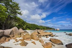 Paradise beach at anse lazio on the seychelles 24. Turquoise water, granite rocks and palm trees in the white sand on the paradise beach at anse lazio on the Royalty Free Stock Photography