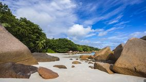 Paradise beach at anse lazio on the seychelles 31. Turquoise water, granite rocks and palm trees in the white sand on the paradise beach at anse lazio on the Stock Image