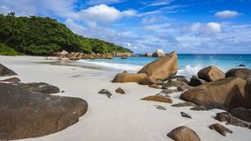 Paradise beach at anse lazio on the seychelles 36. Turquoise water, granite rocks and palm trees in the white sand on the paradise beach at anse lazio on the Stock Image