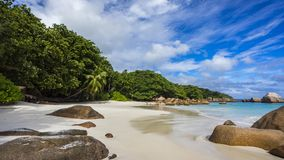 Paradise beach at anse lazio on the seychelles 44. Turquoise water, granite rocks and palm trees in the white sand on the paradise beach at anse lazio on the Royalty Free Stock Images
