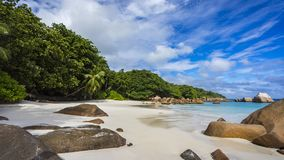 Paradise beach at anse lazio on the seychelles 46. Turquoise water, granite rocks and palm trees in the white sand on the paradise beach at anse lazio on the Stock Image