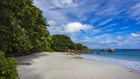 Paradise beach at anse lazio on the seychelles 53. Turquoise water, granite rocks and palm trees in the white sand on the paradise beach at anse lazio on the Stock Photos
