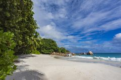 Paradise beach at anse lazio on the seychelles 66. Turquoise water, granite rocks and palm trees in the white sand on the paradise beach at anse lazio on the Royalty Free Stock Photography