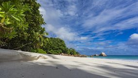 Paradise beach at anse lazio on the seychelles 71. Turquoise water, granite rocks and palm trees in the white sand on the paradise beach at anse lazio on the Stock Images