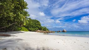 Paradise beach at anse lazio on the seychelles 86. Turquoise water, granite rocks and palm trees in the white sand on the paradise beach at anse lazio on the Royalty Free Stock Photo