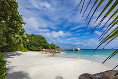 Paradise beach at anse lazio on the seychelles 59. Turquoise water, granite rocks and palm trees in the white sand on the paradise beach at anse lazio on the Royalty Free Stock Image