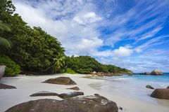 Paradise beach at anse lazio on the seychelles 41. Turquoise water, granite rocks and palm trees in the white sand on the paradise beach at anse lazio on the Stock Photography