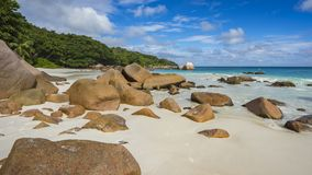 Paradise beach at anse lazio on the seychelles 23. Turquoise water, granite rocks and palm trees in the white sand on the paradise beach at anse lazio on the Stock Photos