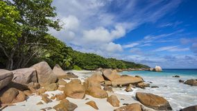 Paradise beach at anse lazio on the seychelles 25. Turquoise water, granite rocks and palm trees in the white sand on the paradise beach at anse lazio on the Stock Image
