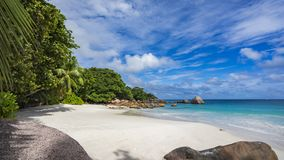 Paradise beach at anse lazio on the seychelles 58. Turquoise water, granite rocks and palm trees in the white sand on the paradise beach at anse lazio on the Stock Photos