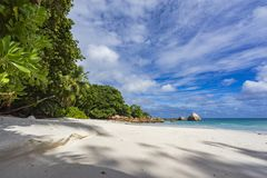 Paradise beach at anse lazio on the seychelles 77. Turquoise water, granite rocks and palm trees in the white sand on the paradise beach at anse lazio on the Stock Photography