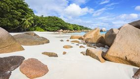 Paradise beach at anse lazio on the seychelles. Turquoise water, granite rocks and palm trees in the white sand on the paradise beach at anse lazio on the Royalty Free Stock Image
