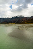 Turquoise Water Gulkana River Flows by Alaska Range. Big water flows through the Alaska Range Stock Photos