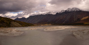 Turquoise Water Gulkana River Flows by Alaska Range. Big water flows through the Alaska Range Stock Images