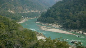 Turquoise water of the holy river Ganges near Rishikesh. The turquoise water of the Ganges flows through a river bend near the town Rishikesh stock footage