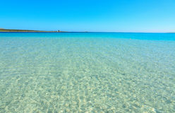 Turquoise water in La Pelosa. Beach, Italy Royalty Free Stock Images