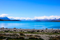 Turquoise Water in Lake Pukaki with Mount Cook Background Stock Photos