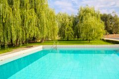 Turquoise water in a large outdoor pool in the park area. Turquoise water in a large outdoor pool stock photo