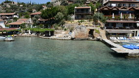 The turquoise water near beach and outdoor restaurants in Kekova stock video