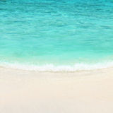Turquoise water of the ocean and white sand Stock Photos