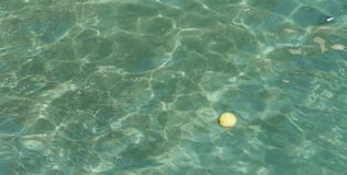 Turquoise water, reflections on water surface. A ball in beautiful clean turquoise sea water with reflections on water surface royalty free stock photos