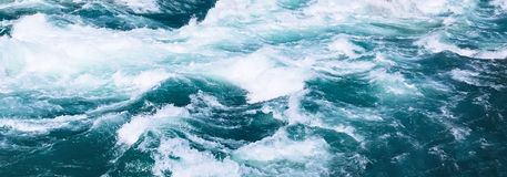 Turquoise water river splashing banner. Abstract turquoise water river from glacier splashing closeup banner background stock photography