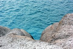 Turquoise water and rocky cliffs royalty free stock photography