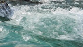 Turquoise water stream. A flow of turquoise water in the mountain river, Alberta, Canada, RAW video stock footage
