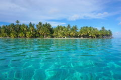 Turquoise water tropical islet French Polynesia Stock Photo