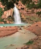 Havasu Falls in Arizona. Turquoise water tumbles over the travertine cliffs and fills the pool beneath Havasu Falls in Havasu Canyon stock photos