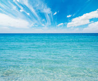 Turquoise water under a blue sky. In Sardinia, Italy Royalty Free Stock Photography