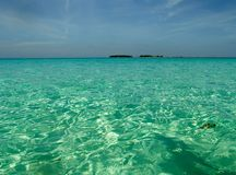 Turquoise Water. A view of the crystal blue waters in Cuba, and  a small island in the distance Royalty Free Stock Photo