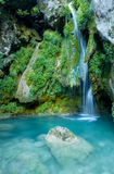 Turquoise waterfall from urederra river Royalty Free Stock Photography
