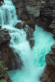 Turquoise waterfall. Turquoise water pouring over rocks and on as the river Royalty Free Stock Photo