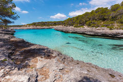 Turquoise waters of a bay in the Mondragó Natural Park, Mallorc Royalty Free Stock Photography