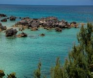 Turquoise Waters of Bermuda. Turquoise waters along the shoreline in Bermuda. The Atlantic Ocean is in the background royalty free stock image